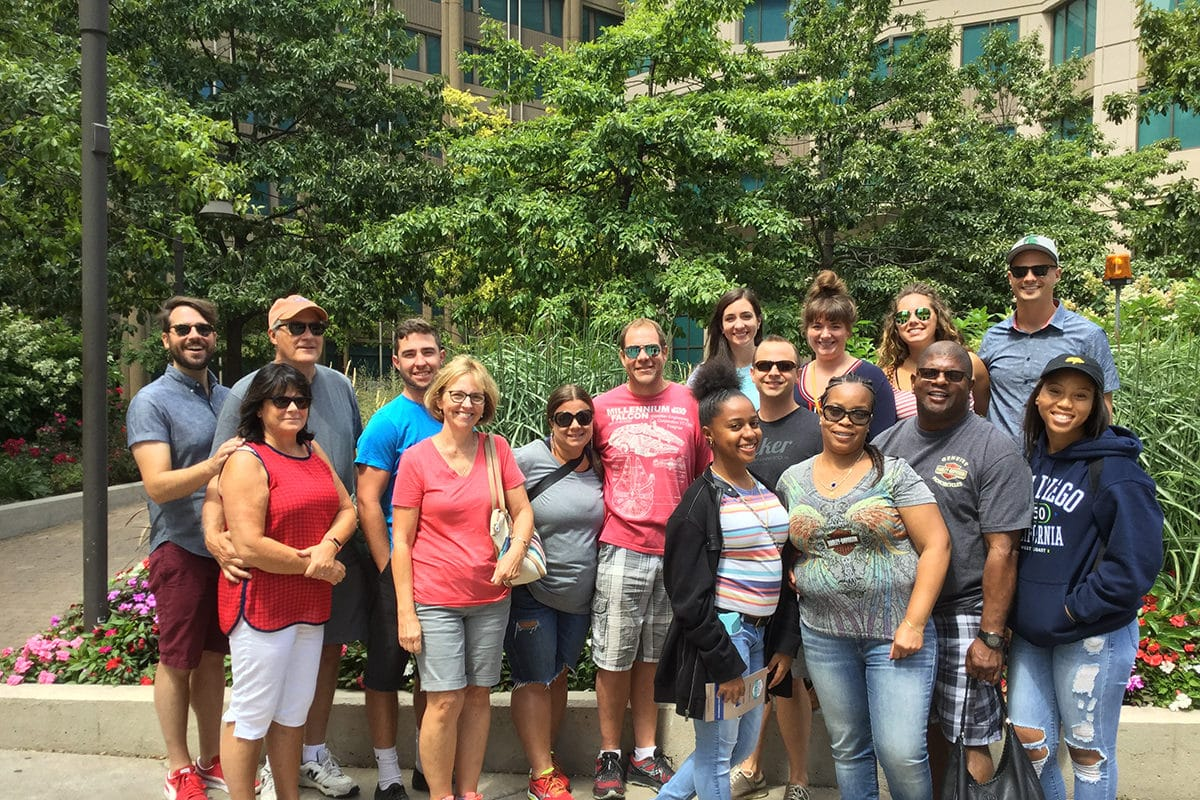 Group Of 16 people standing in front of greenery at a park on Best In Chow Walking Food Tour