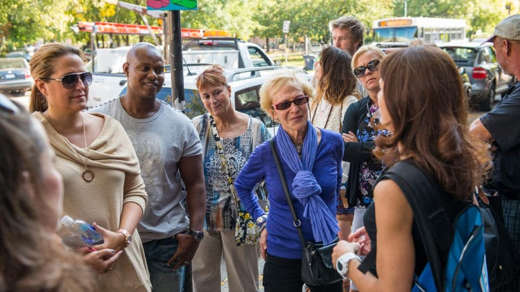 Individuals on a 3-1-Chew Bucktown Wicker Park Food Tour stand outside learning the history of the neighborhood and it's restaurants.