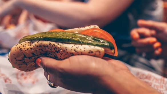 Woman holding a Chicago-style hot dog from Portillos